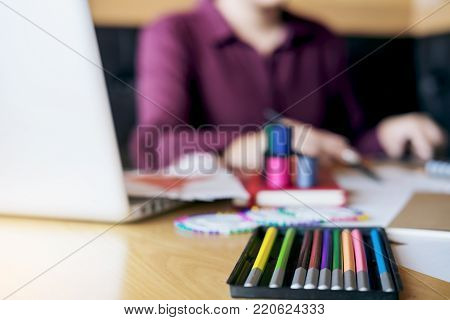 Young woman dressmaker or designer working as fashion designers and drawing sketches for clothes and choose color bar in tablet, profession and job occupation, Fashion Designer Stylish Concept.