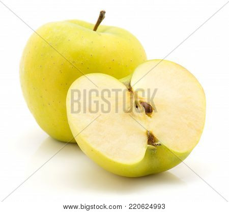 Apples (Smeralda variety) isolated on white background green yellow one whole and one half cross section