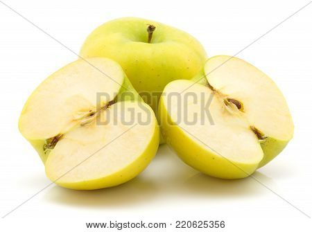 Apples (Smeralda variety) isolated on white background green yellow one whole one cut in half two cross section halves