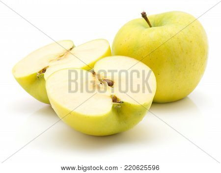 Two apple (Smeralda variety) halves and one whole isolated on white background green yellow