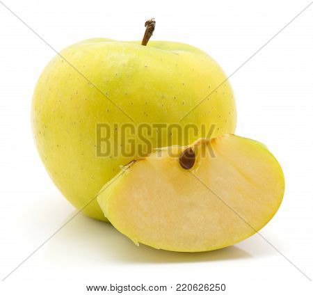 One apple (Smeralda variety) with a juicy slice isolated on white background