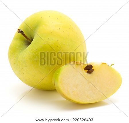 One apple (Smeralda variety) with a slice isolated on white background