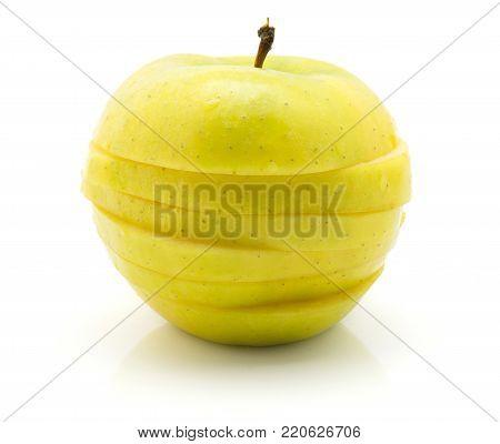 Sliced apple (Smeralda variety) isolated on white background one whole