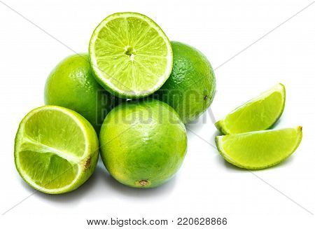 Group of whole, sliced lime and halves isolated on white background