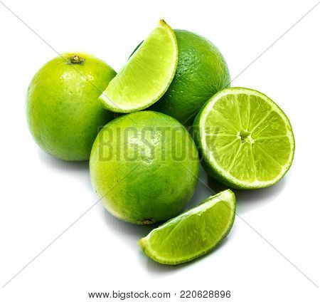 Group of whole, sliced lime and half isolated on white background