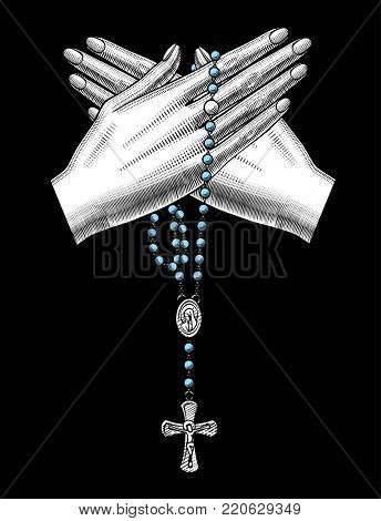 Crossed woman's hand with catholic prayer beads on black. Vintage engraving stylized drawing