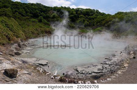 The hot water of Oyunuma pond in the volcanic landscape of Hell Valley (Jigokudani), Noboribetsu, Hokkaido, Japan
