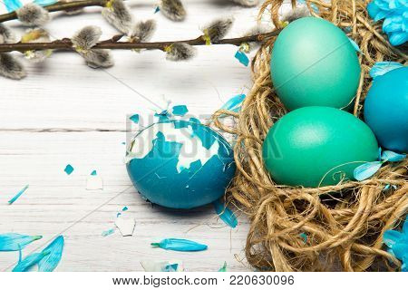 Easter background with eggs, nest and catkins, copy space