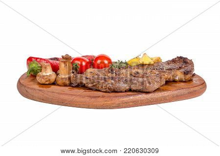 Grilled Steak Served On Wooden Plate On White