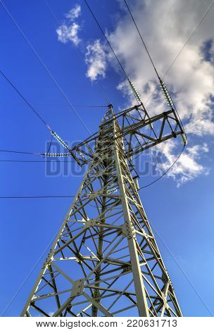 High voltage electrical overhead line on blue sky