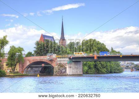 FRANKFURT AM MAIN, GERMANY - May 07.2014: City landscape. Main river embankment and bridge