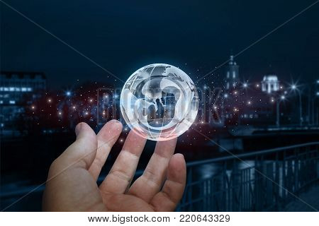 Hand showing earth with a human embryo on blurred background. The concept of inception.