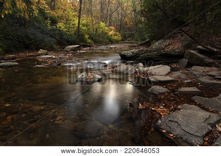 Beautiful autumn light filtered onto Looking Glass Creek near Brevard, North Carolina in the Pisgah Forest.