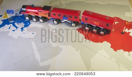 Toy train connecting Europa and China. Symbolizing the New Silk Road or one belt one road Chinese strategic investment in the 21st century. Economic project to connect EU, Central Asia and China