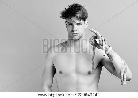 Weight Management Restrictions Idea. Man With Concentrated Face And Rulers