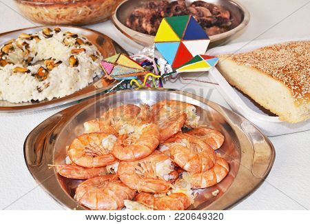 Clean Monday food with shrimps, the greek bread lagana and decorative kites
