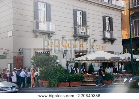 NAPLES, ITALY - SEPT 9, 2008: People stay at old cafe Gambrinus on Piazza Trieste e Trento in Naples, ITALY on Sept 9, 2008. Gambrinus was founded in 1860.