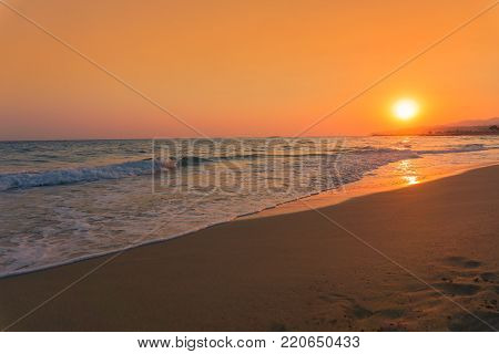 View to a amazing Sunset at the Beach. Close-up of a beautiful Sunset at a deserted Beach. Beach and Travel Backgrounds.
