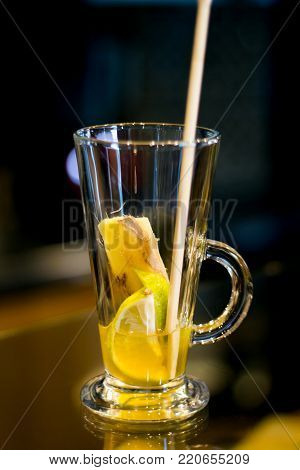 warmer drink concept, cup with warming alcohol cocktail recipe ingredients, winter holidays drink.