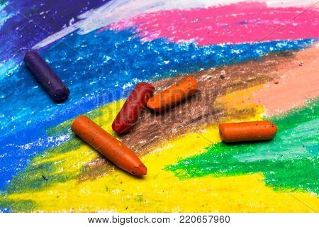 Photo of colorful drawing and oil pastels crayons, texture for background. Selective focus