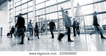 Blurred Business People At A Trade Show Convention