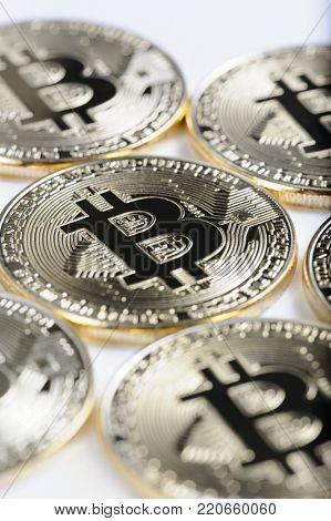 Macro view of shiny Bitcoin souvenire coins as background, selective focus