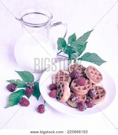 raspberry, milk in a jar and cookies