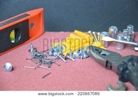 Top view of Working tools, wrench, socket wrench, hammer, screwdriver, plier, electric drill, tape measure, machinist square on wooden board. flat lay design.