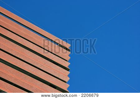 Blue Sky And Red Brick Building On The Diagonal