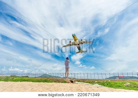 PHUKET, Thailand - October 23, 2017 : Bangkok Airways airplane flying take off at Phuket International Airport, Mai Khao Beach, Phuket province, Southern of Thailand.