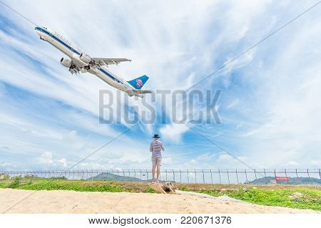 PHUKET, Thailand - October 23, 2017 : China Southern Airbus 330-300 airplane flying take off at Phuket International Airport, Mai Khao Beach, Phuket province, Southern of Thailand.
