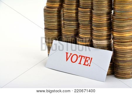 Word vote with coins isolated on white background