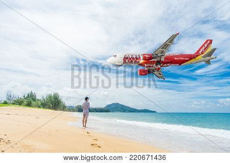 PHUKET, Thailand - October 23, 2017 : Vietjet airline airplane flying landing at Phuket International Airport, Mai Khao Beach, Phuket province, Southern of Thailand.