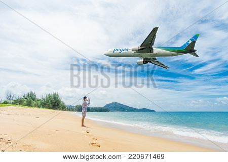 PHUKET, Thailand - October 23, 2017 : Pegas airways airplane flying landing at Phuket International Airport, Mai Khao Beach, Phuket province, Southern of Thailand.