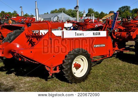 DALTON,  MINNESOTA, Sept 8, 2017: A McCormick Deering manure spreader names Trump's Wagon  is displayed at the annual Dalton Threshing Bee farm show in Dalton held each 2nd full weekend in September where 1000's attend.