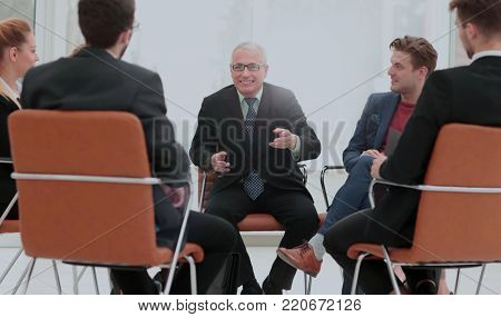 Head of the new business project holds a meeting with his busine