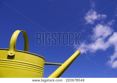 Whimsical Watering Can With Clouds as Steam in the Sky