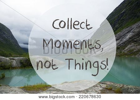 English Quote Collect Moments Not Things. Lake With Mountains In Norway. Cloudy Sky. Peaceful Scenery, Landscape With Rocks And Grass. Greeting Card