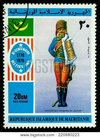 Moscow, Russia - January 04, 2018: A stamp printed in Mauritania, shows Officer of Hussars of Lauzun, series