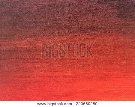Close-up macro shot of red paint on canvas. Fragment of gradient picture on wall