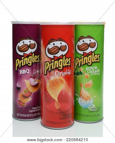 IRVINE, CA - JANUARY 4, 2018: Three Pringles Cans. Pringles ia a brand of potato and wheat based stackable snack chips
