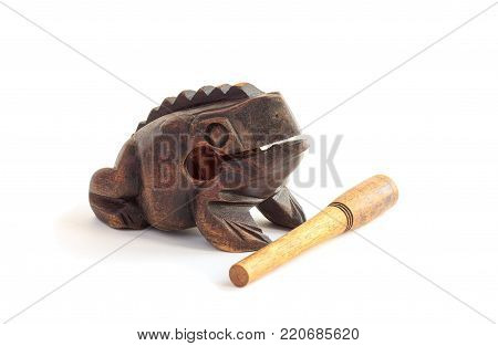 Wooden money frog, a traditional Thai souvenir. Brings good luck and money. Isolated on white background.