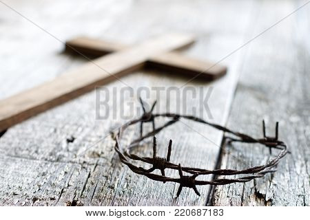 Easter abstract background with  crown of thorns and cross on wooden planks