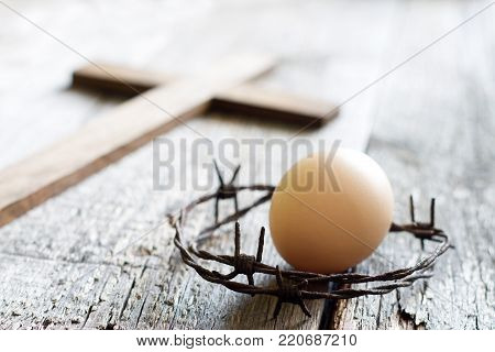 Abstract easter egg and crown of thorns on vintage retro wooden old background