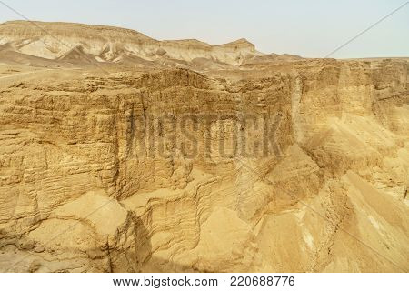 Landscape view of desert rock near dead sea in Israel. Valley of sand, mountains and stones in hot middle east tourism place. Scenic outdoor infinity on wild land. Summer heat and nobody on photo