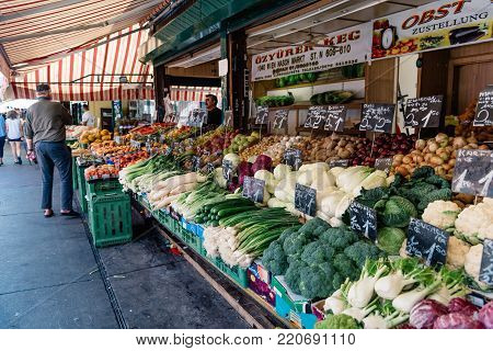 Vienna,  Austria - August 17, 2017: Naschmarkt in Vienna. It is a food and flea market, located in front of Majolika House by Otto Wagner