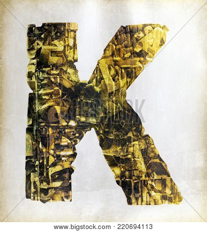 big uppercase letter  K  layers of metalic gold letters
