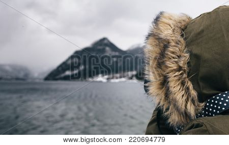 woman taking photograph at winter scenery