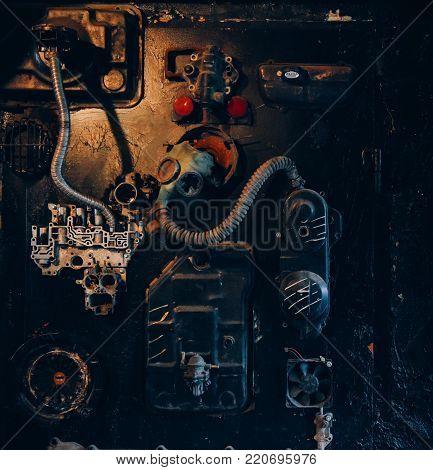 A monstrous machine in dark room, steel pipe.