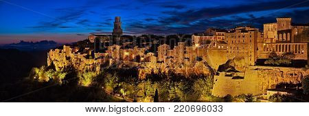 Pitigliano, Grosseto, Tuscany, Italy: landscape at dusk of the picturesque medieval town founded in Etruscan time on the tuff hill
